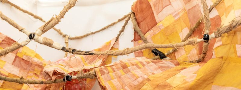 Installation of artwork made from armature wire, burlap, hand-dyed cotton and silk.
