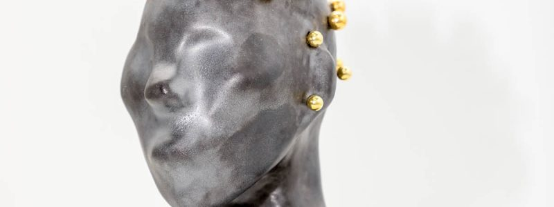Installation shot of ceramic sculpture bust.
