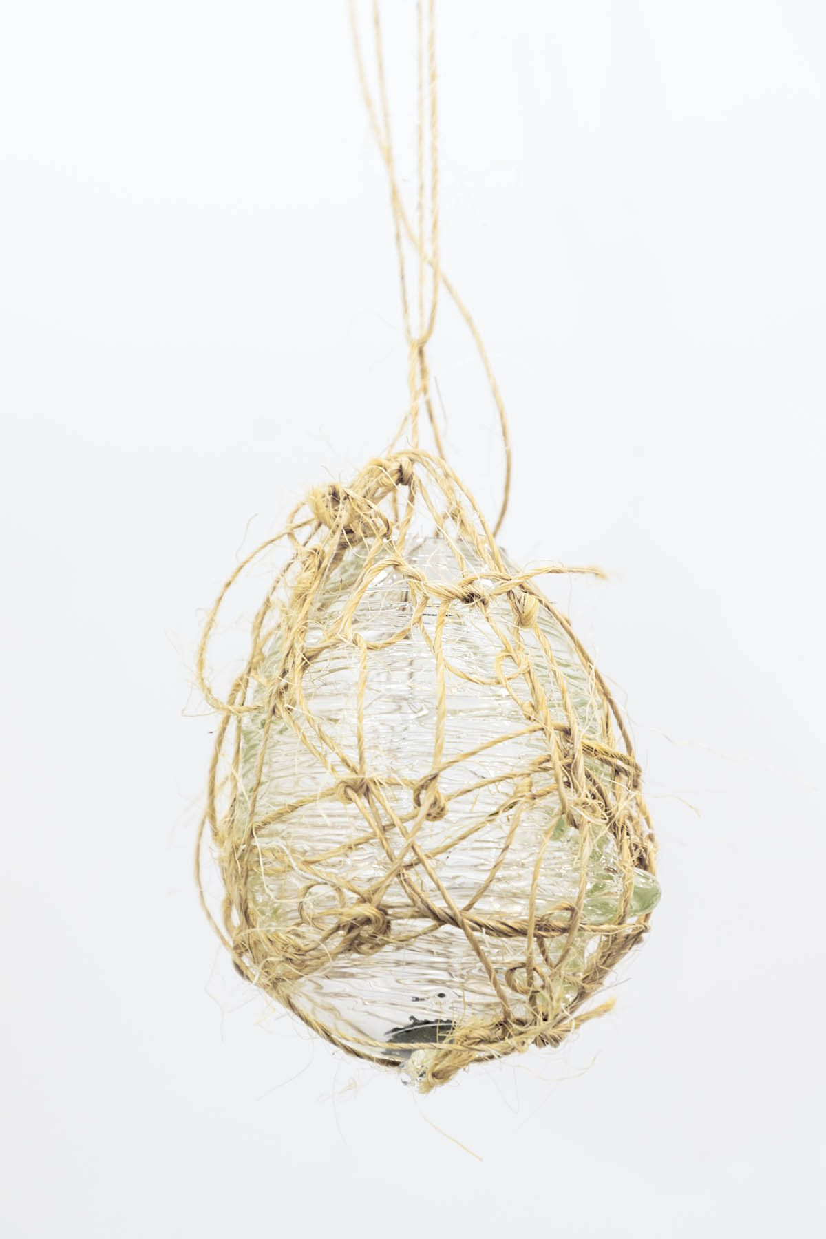 Image representing Xuan Guan's performance, object in glass, fabric, wire, and wood.
