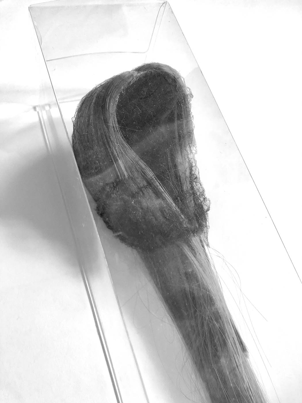 Black and white photo of lock of hair.